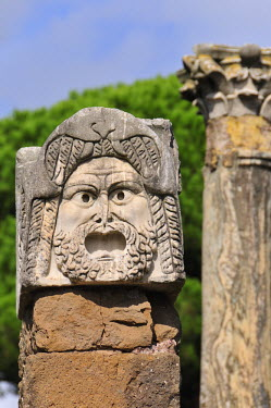 ITA2481AW Mask of the theatre of the roman city of Ostia Antica at the mouth of the River Tiber, Ostia, Rome, Italy