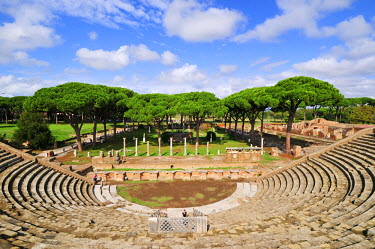 ITA2480AW The Theatre and, in the background, the Market square of Ostia Antica, at the mouth of the River Tiber, Ostia, Rome, Italy