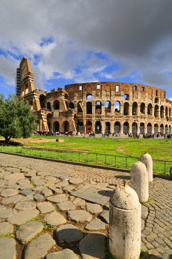 ITA2411AW The Colosseum or Coliseum and a roman stone pavement on the foreground. The construction began under the emperor Vespasian in 70 AD and was completed in 80 AD under his successor Titus. It could hold...