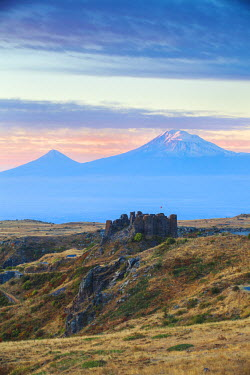 AM01145 Armenia, Aragatsotn, Yerevan, Amberd fortress located on the slopes of Mount Aragats, with Mount Ararat in the distance