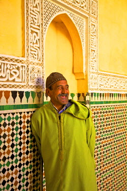 MC02752 Smiling Man In Traditional Costume, Prayer Hall, Interior Of Mausoleum of Moulay Ismail, Meknes, Morocco, North Africa