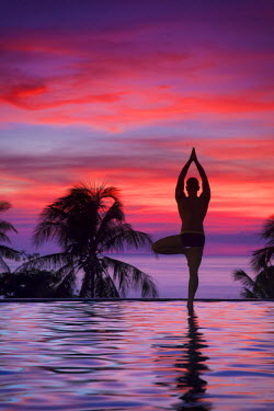 PH02169 Philippines, Visayas, Boracay Island, Man practising Yoga (Tree Pose) at luxury resort