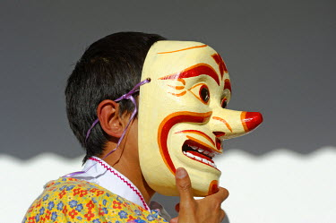 ECU1224 Ecuador, Cotopaxi, Latacunga. A young boy wears a clown mask as one of the characters in the 'Fiesta de la Mama Negro', a popular annual celebration in Latacunga that fuses indigenous Quechua and Hisp...