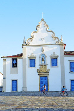 BRA2177AW South America, Brazil, North East, Sergipe, Sao Cristovao, children riding bicycles in front of the 17th Century baroque Carmelite convent (Convento do Carmo)