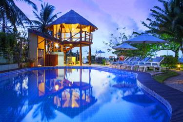 BRA2214AW South America, Brazil, Alagoas, Praia do Riacho, sun loungers around the pool at the Pousada Riacho Dos Milagres boutique hotel PR