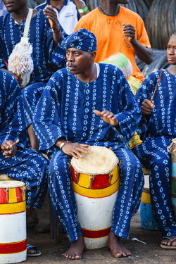 AF03ALA0336 Africa, Benin, Cotonou. Band performing in traditional dress at port.