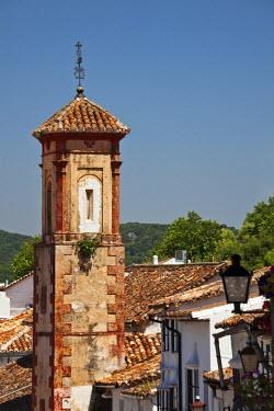 EU27JEG0163 Spain, Andalucia Region, Cadiz Province, Grazalema. The bell tower of Iglesia de San Juan, an 18th century religious monument.