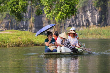 Vietnam, Ninh Binh Province, Tam Coc. Boating on a stretch of the Ngo Dong River.