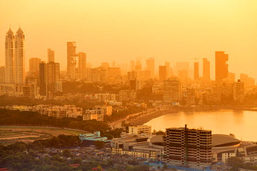 IND7549AW India, Maharashtra, Mumbai, sunset over the city centre and Haji Ali Bay showing the Imperial twin-tower residential skyscraper complex, Lala Lajpatrai Marg road, Sardar Vallabhbhai Patel stadium, the...