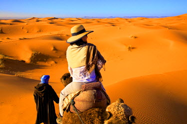 MC02882 Tourist On A Camel With Berber Man, Morocco, North Africa (MR)