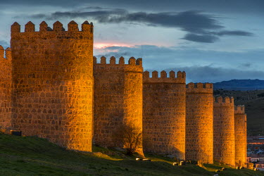 SPA5205AW The medieval city walls illuminated at dusk, Avila, Castile and Le�n, Spain