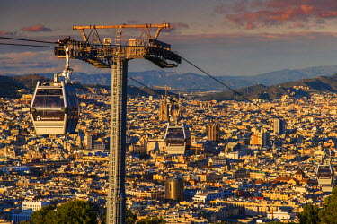 SPA5248AW Teleferic de Montjuic or aerial tramway with city skyline at sunset, Barcelona, Catalonia, Spain