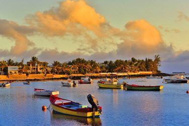 HMS1771166 Reunion island (French overseas department), Etang Sale, Etang Sale les Bains, seascape, small fishing harbor at sunset with boats in the foreground view