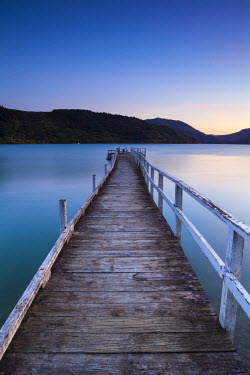 NZ02424 Picturesque wharf illuminated at dusk, Kenepuru Sound, Marlborough Sounds, South Island, New Zealand