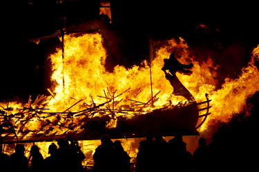 SCO33220 Scotland, Shetland Islands, Lerwick. The spectacular burning of the Galley after the night torch procession