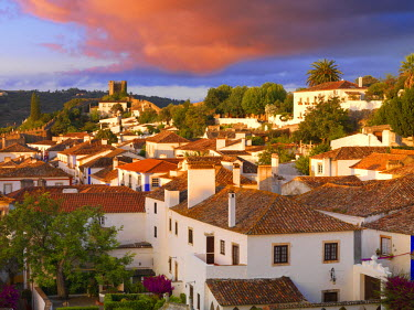 POR7629AW Portugal, Estramadura,Obidos, overview of 12th century town at dusk