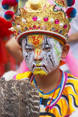 TAI0093AW Boy with face paint at Matsu festival, Dajia, Taiwan