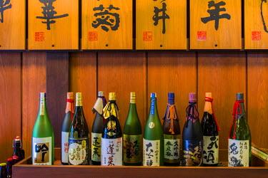 JAP0577AW Sake bottles in a sake brewery, Takayama, Gifu Prefecture, Japan