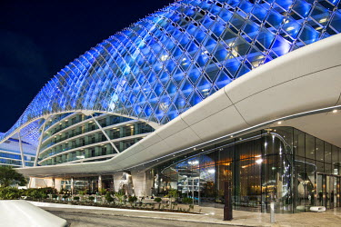 UAE0184 Entrance lobby of the Yas Viceroy Abu Dhabi Hotel designed by the architects Asymptote Architecture by night in Yas West, Abu Dhabi, United Arab Emirates.