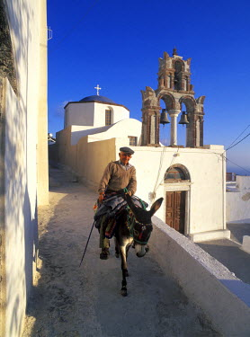 HMS0072180 Greece, Cyclades islands, Santorini Island, village of Pyrgos, a church and a man on his donkey