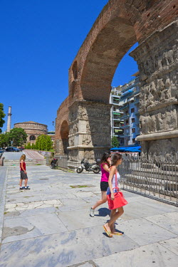 Greece, Macedonia, Thessaloniki, Arch of Galerius, triumphal arch built in the 4th century to honor the emperor Galerius and the Rotunda or Agios Giorghos church in the background
