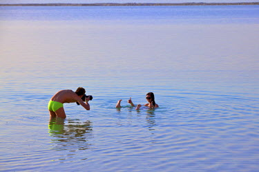 IS30254 Floating In The Dead Sea (lowest place on Earth), Ein Bokek, Israel, Middle East