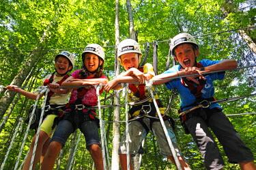GER8162AW Climbing children in Reit im Winkl, Chiemgau, Bavaria, Germany (MR)