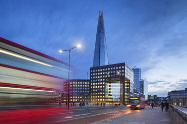 FVG005680 UK, London A view of The Shard from London Bridge at dusk with a tipycal London Double decker red bus