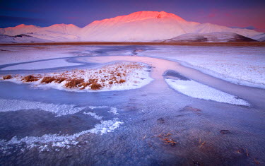FVG004786 Italy, Marche, Fantastic sunset at -18 � on the plain of Castelluccio di Norcia in the middle of winter.