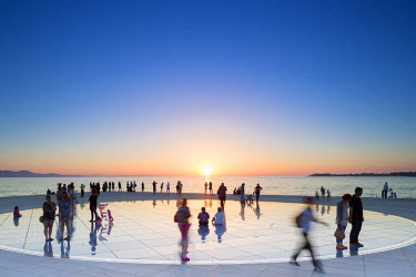 CRO1252AW Croatia, Zadar Region, Zadar. Sunset at the Greeting to the Sun, a 22 metre installation consisting of 300 multi-layered glass plates, designed by Nikola Basic.