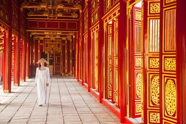 VIT0501AW Woman wearing Ao Dai dress in Imperial Palace inside Citadel, Hue, Thua Thien-Hue, Vietnam (MR)