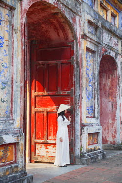 VIT0509AW Woman wearing Ao Dai dress at Dien Tho inside Citadel, Hue, Thua Thien-Hue, Vietnam (MR)