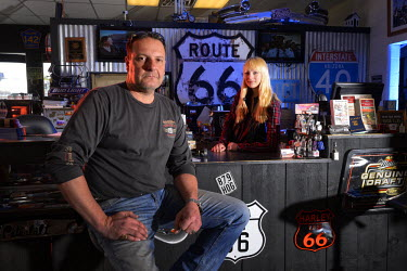 USA9253AW Owner Peter Fischer with Angelina, Eagle Rider Harley store and shop on route 66, Arizona, USA