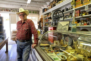 USA9271AW Store owner Don Edmund in General store, Chloride Ghost Town, New Mexico, USA