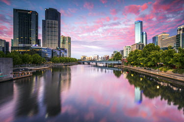 AUS1994AW Melbourne, Victoria, Australia. Yarra river and city at sunrise, with RIalto towers on the right