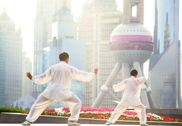 CH10223AW China, Shanghai. Chinese men practising Tai Chi on the Bund (MR)