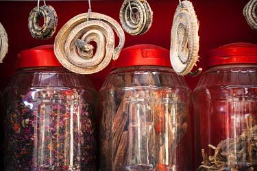 CH10237AW China, Xinjiang, Kashgar. Dried snakes for sale at local market
