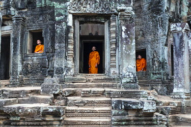 CMB1401AW Cambodia, Siem Reap, Angkor Wat complex. Monks inside Bayon temple (MR)
