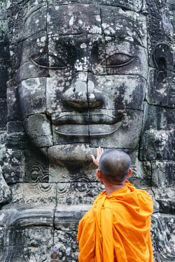 CMB1402AW Cambodia, Siem Reap, Angkor Wat complex. Monks inside Bayon temple (MR)