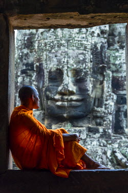 CMB1403AW Cambodia, Siem Reap, Angkor Wat complex. Monks inside Bayon temple (MR)