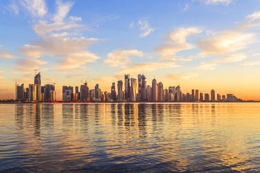 QAT0003AW Qatar, Doha. Cityscape at sunrise from the Corniche
