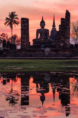THA0752AW Thailand, Sukhothai Historical Park. Wat Mahathat temple at sunset