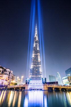 UAE0265AW United Arab Emirates, Dubai. Burj Khalifa at dusk, with light show