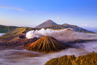 IDA0642 Indonesia, Java, Bromo. A stunning volcanic landscape from Mount Penanjakan at sunrise.  Active Mount Bromo (left) and Mount Batok (centre foreground) lie in the Sea of Sand with Mount Semeru in the d...