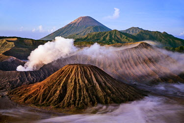 IDA0643 Indonesia, Java, Bromo. A stunning volcanic landscape from Mount Penanjakan at sunrise.  Active Mount Bromo (left) and Mount Batok (centre foreground) lie in the Sea of Sand with Mount Semeru in the d...