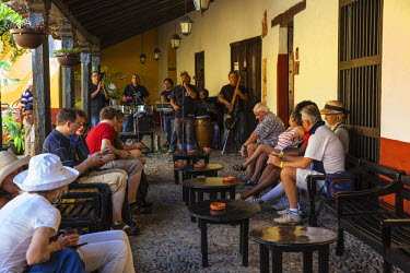 CB02189 Cuba, Trinidad, Band playing to Tourists at Bar La Canchanchara -  - famous for its house cocktail made from rum, honey, lemon and water served in an earthenware bowl