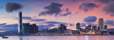 CH10301AW Tsim Sha Tsui and West Kowloon skyline at sunset, Kowloon, Hong Kong
