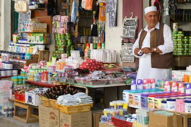 AF55CCE0456 Tripoli, Libya. Street Scene, Shop Vendor in Traditional Male Dress, Medina.