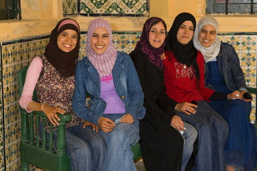 AF55CCE0480 Tripoli, Libya. Young Libyan Women. These women have adopted western European or American clothing styles while maintaining the Libyan custom of covering the hair with a scarf.