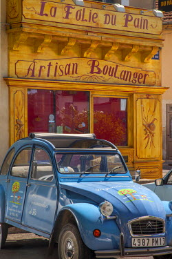 EU09BJN1039 A Deux Chevaux car by Citroen parked in front of bakery in Saint Remy de-Provence, France.